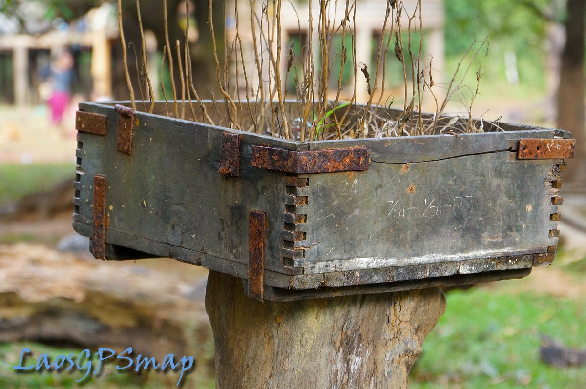 War remains in the form of a wooden box that carried guns. Ho Chi Minh Trail Southern Laos