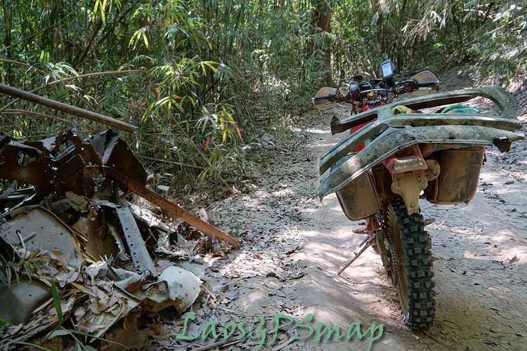 Cambodia abandoned area of the Ho Chi Minh trail are piles of scrap and destoryed trucks