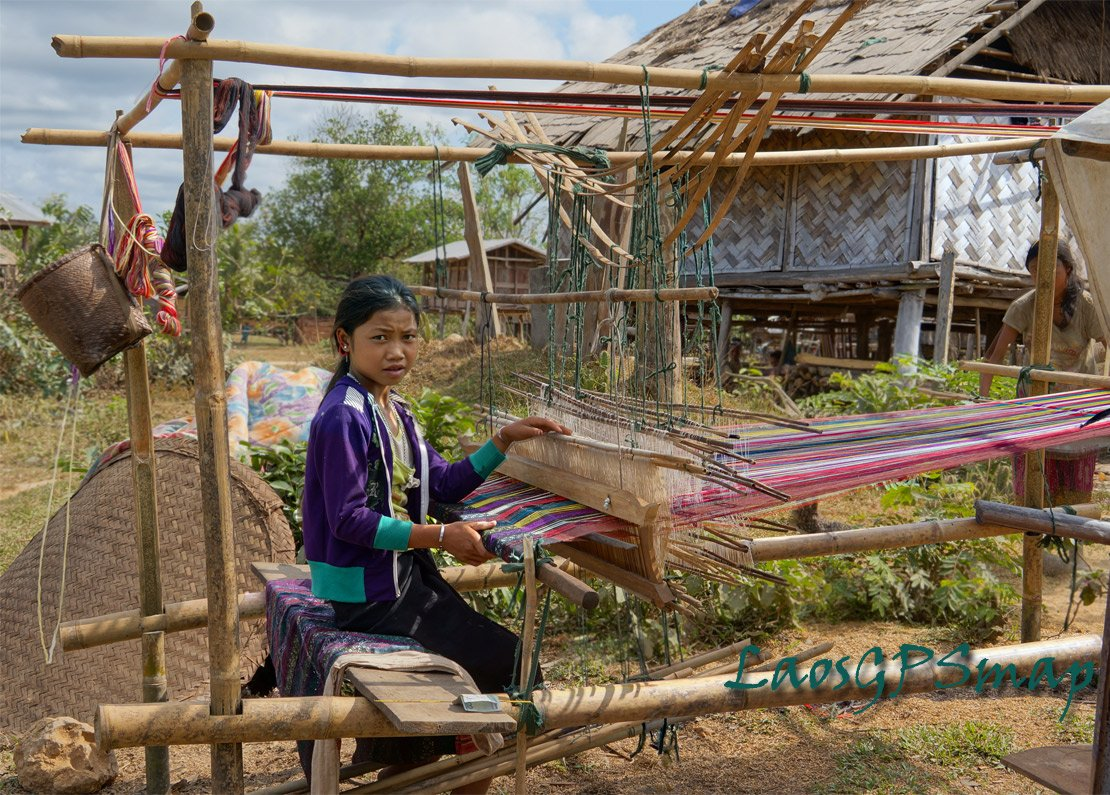 Along the Ho Chi Minh Trail, Mekong villager at work on a natural weaving loom