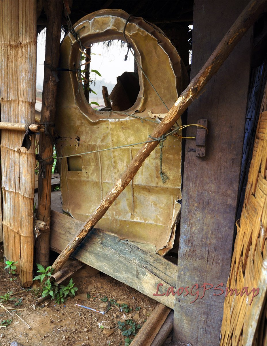 Airplane door being used on a shed in Xam Thong village a relic from the secret war