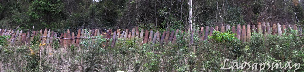Very long Bombie casing fence near Ban Laboy
