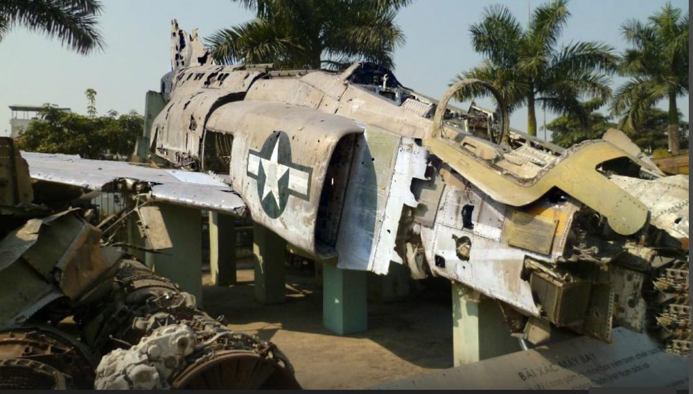 Amid a heap of twisted metal at the People's Air Force Museum in Hanoi emerges the unmistakable form of a McDonnell Douglas F-4 Phantom, which was shot down over North Vietnam on May 14, 1967 The F-4B model Phantom is displayed in pride of place atop other battered US Navy and Air Force relics, including twisted propellers and smashed jet engines. The wrecked warplane, serial number 153001, retained its overall shape despite enormous damage reportedly caused by a Russian-built surface to air missile, and subsequent impact with the ground According to Ejection-History.org.uk, the two crew members, Lt. Cdr. C. E. Southwick and Lt. D. J. Rollins survived the crash and became prisoners of war. The wrecked F-4 had belonged to VF-114 'Aardvarks' aboard the aircraft carrier USS Kitty Hawk, and remains one of the museum's star attractions today. The museum sits at the edge of the unused Bach Mai airfield, providing ample room for this vast junkyard. Obviously, there were many planes parked here permanently, but I found myself more drawn to the plethora of rusted support vehicles. And their awkward and colorful descriptions, like the one describing the bulldozer below: