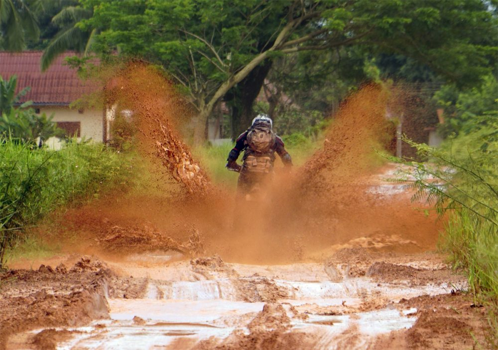 Red Mud and Rain makes for interesting traveling September in Laos