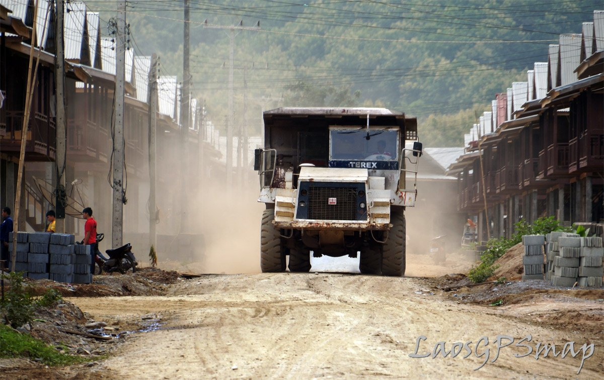 Terex Earth Mover rumbling through resettlement village Hongsa, Laos