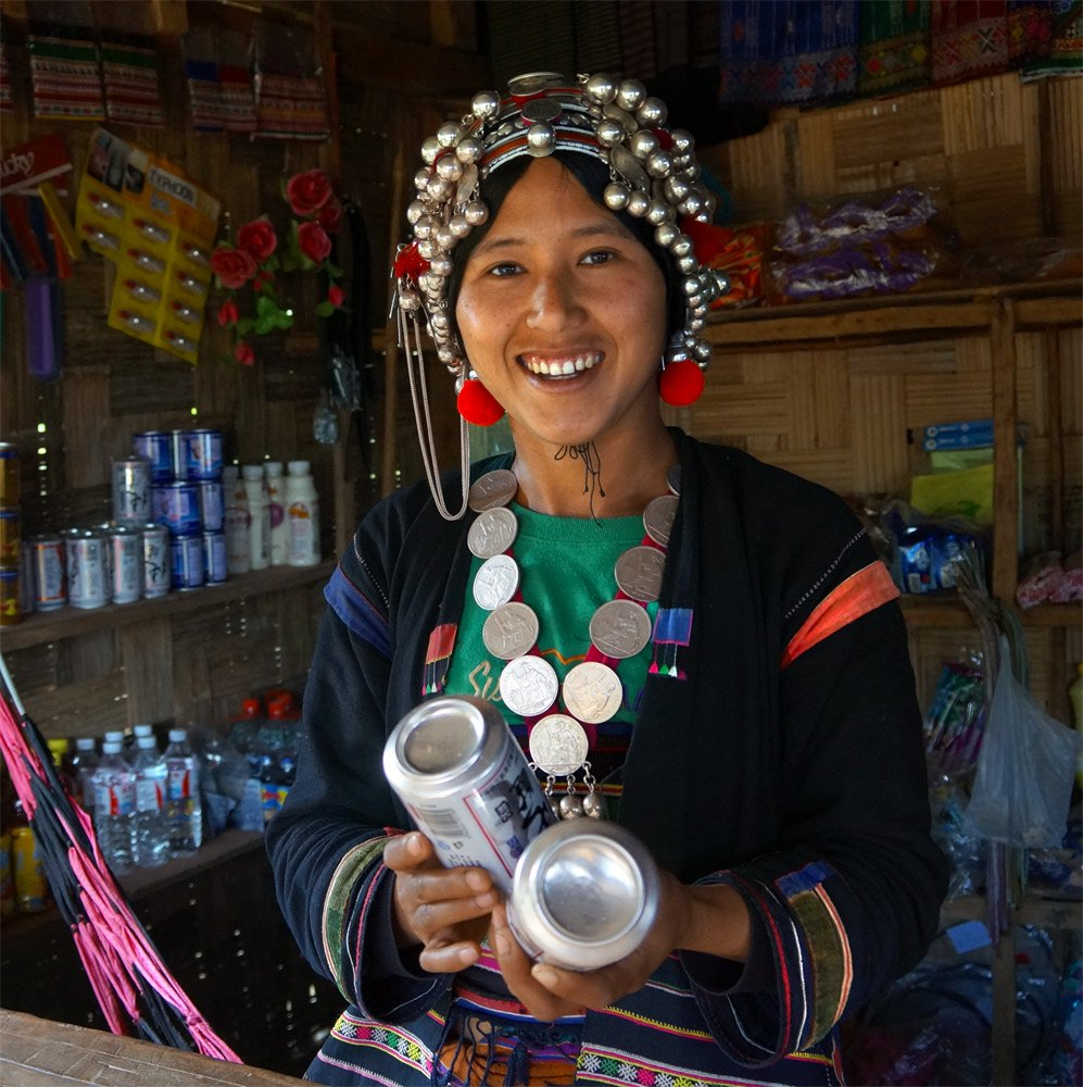 Tribal Villager Northern Laos selling Chinese beer