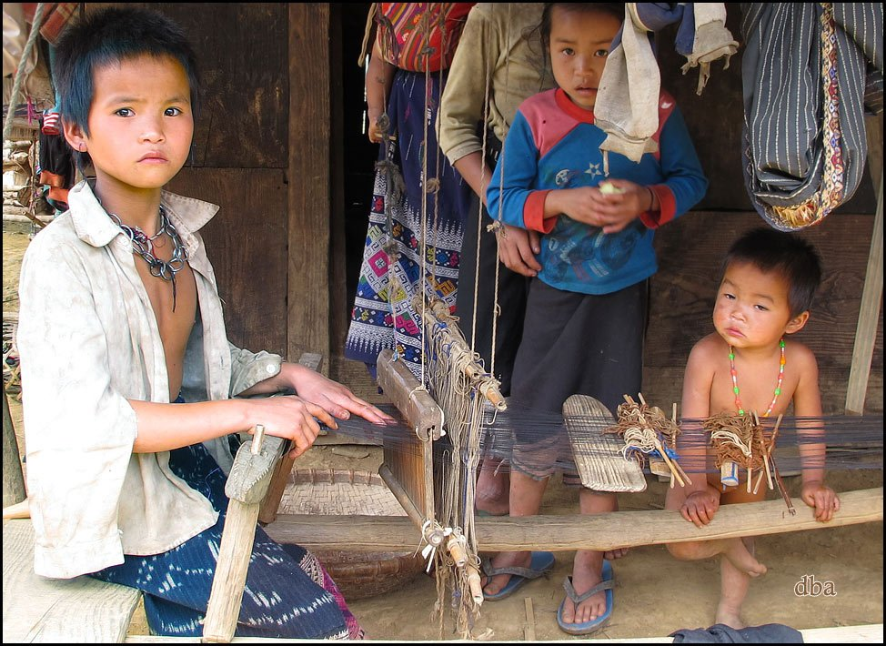 Pou Noi villagers weaving at  young age