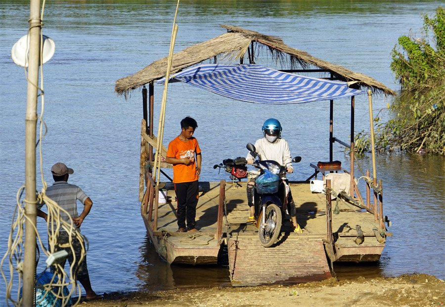 Motorcycle ferry with thatch roof
