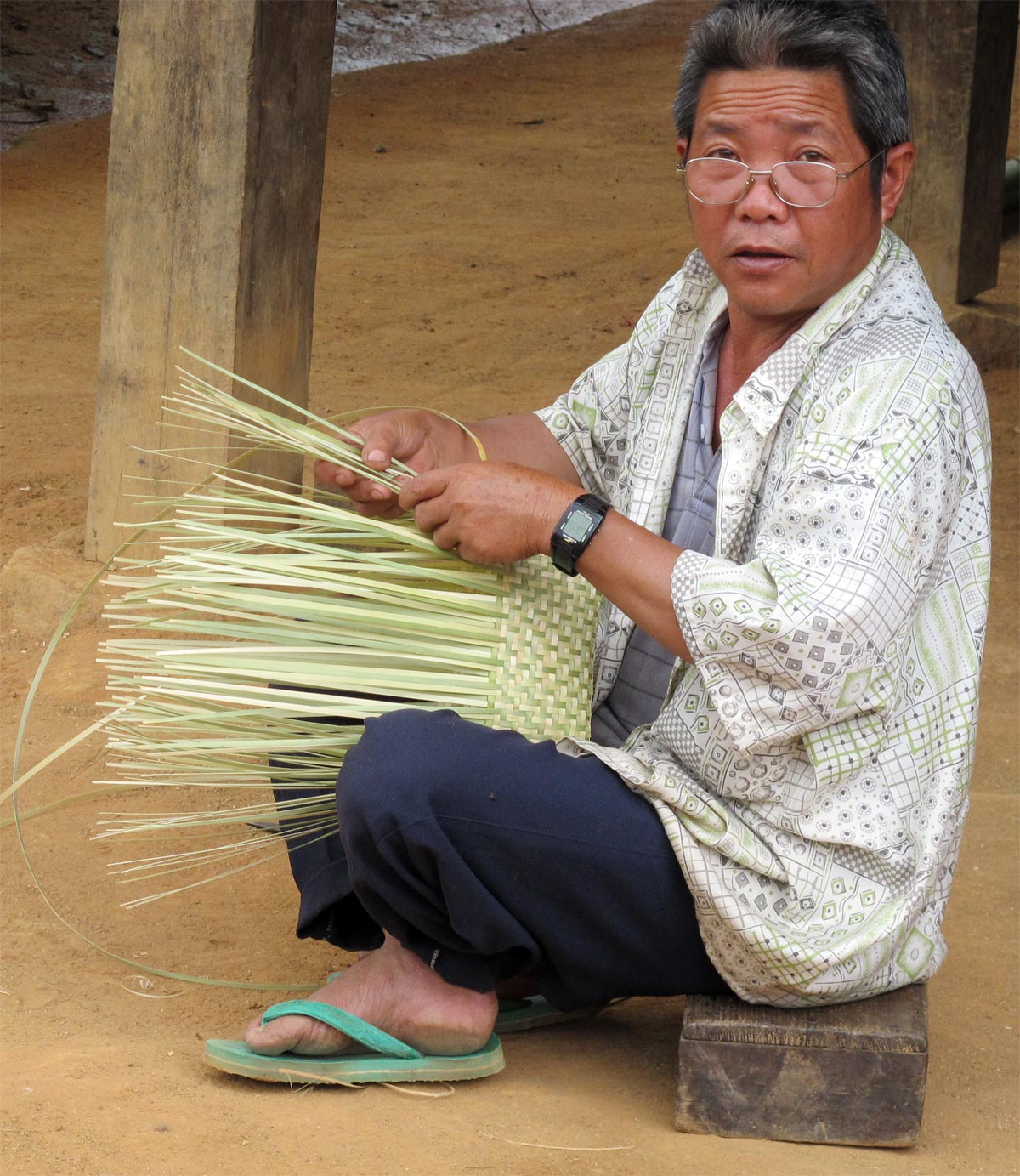 Weaver in village Northern Laos
