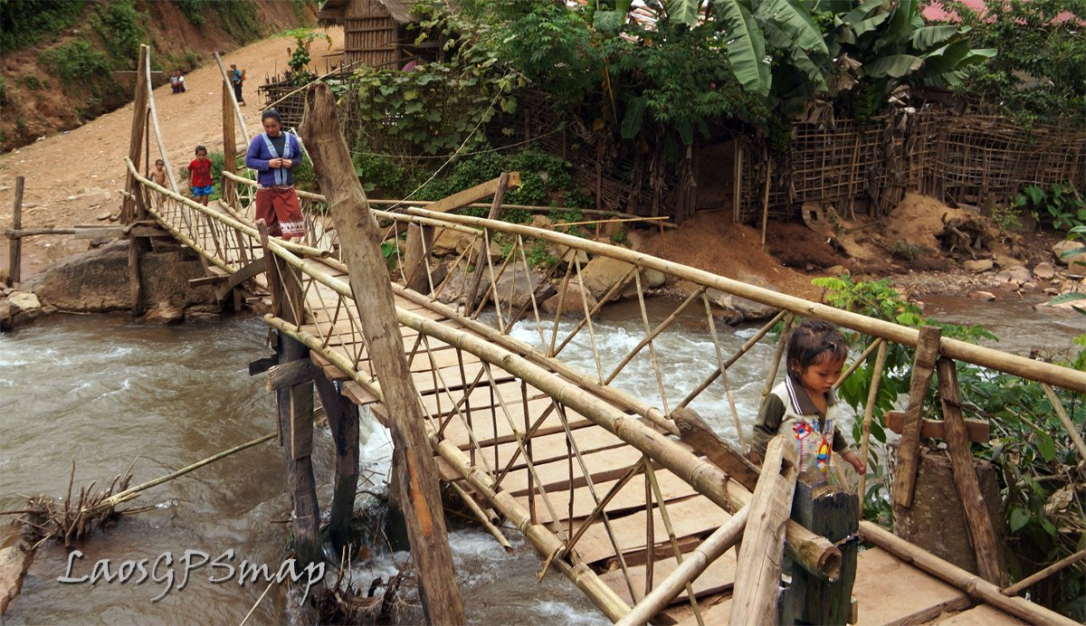 wood bridge over the nam pah